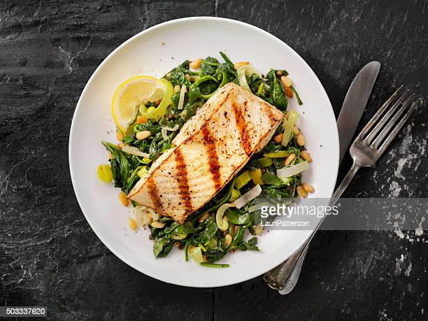 grilled halibut with spinach, leeks and pine nuts - food stock pictures, royalty-free photos & images