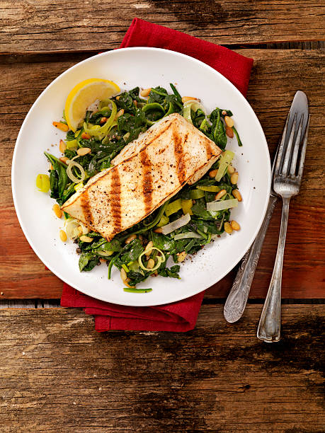 Grilled Halibut With Spinach, Leeks And Pine Nuts Wall Art