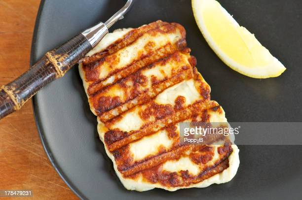 Grilled Halloumi Cheese on Black Plate from Above