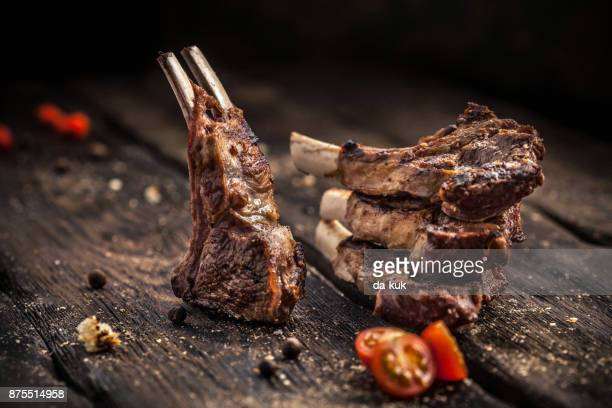 Grilled lamb chops on wooden table