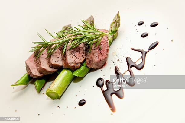 Grilled Lamb Filet on a bed of Green Asparagus