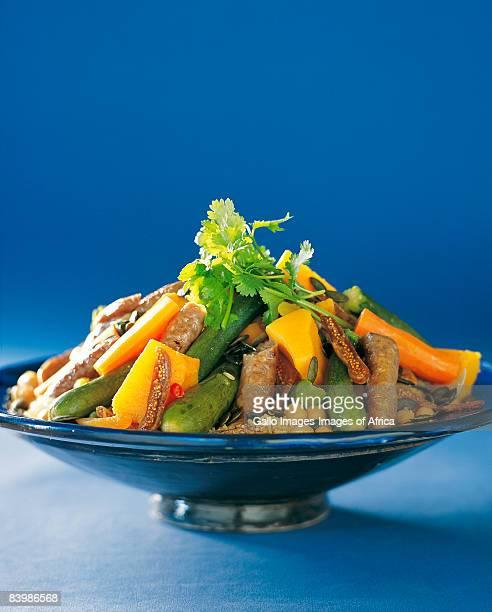 grilled lamb sausage, fruit & vegetable couscous - couscous photos et images de collection