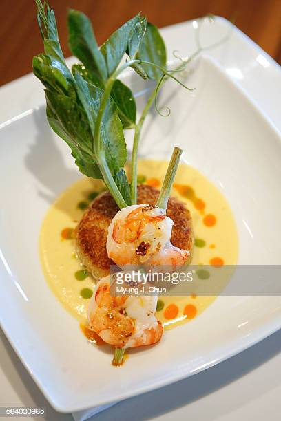 Grilled lemongrass skewered prawns, coconut crusted crab cake with micro basil in sweet corn emulsion is on the menu at Minx in Glendale shot on...