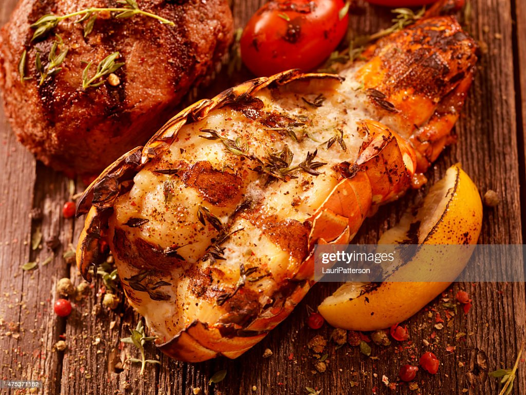 BBQ Grilled Lobster Tail and Steak Fillet : Stock Photo