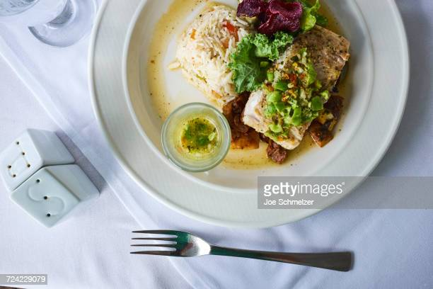 Grilled Mahi Mahi, with fresh vegetables and rice, overhead view