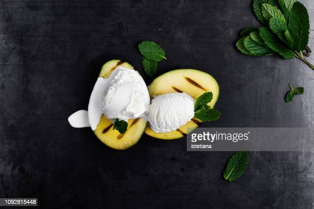 grilled mango with low-calorie ice cream - gourmet stock pictures, royalty-free photos & images