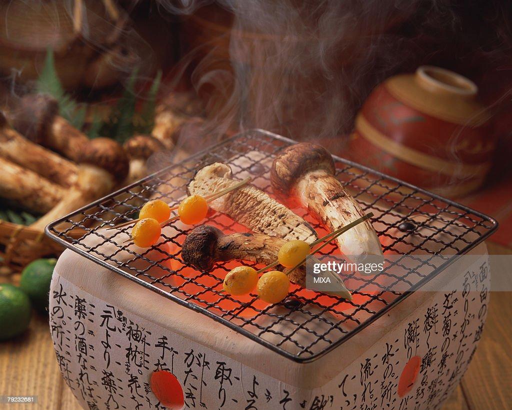 Grilled matsutake mushrooms : Stock Photo