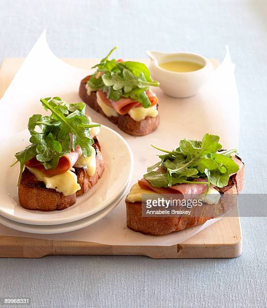 Grilled, open faced ham-brie and arugula sandwich