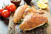 Grilled or smoked chicken breast with bone and skin