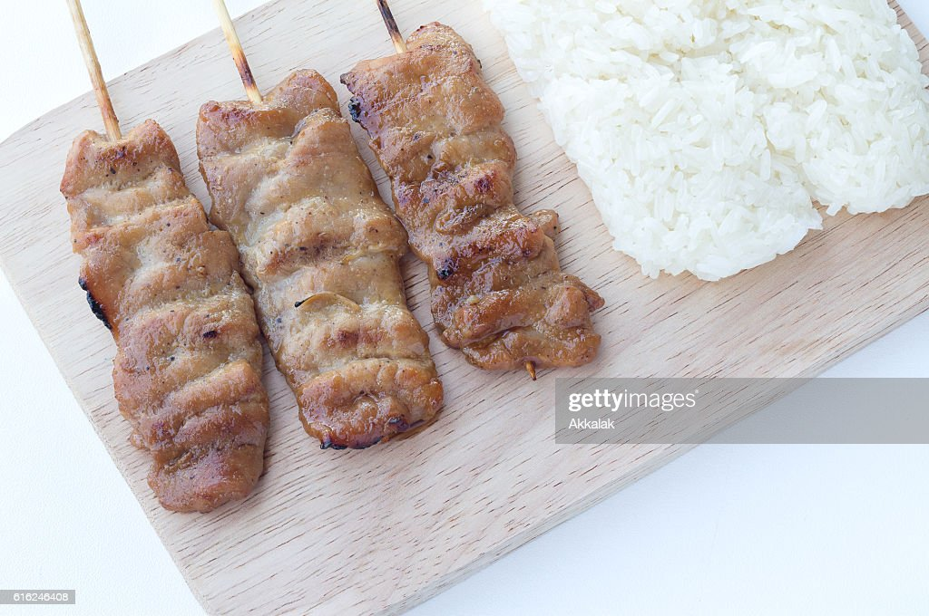 Grilled pork in asian style sticky rice : Stock Photo