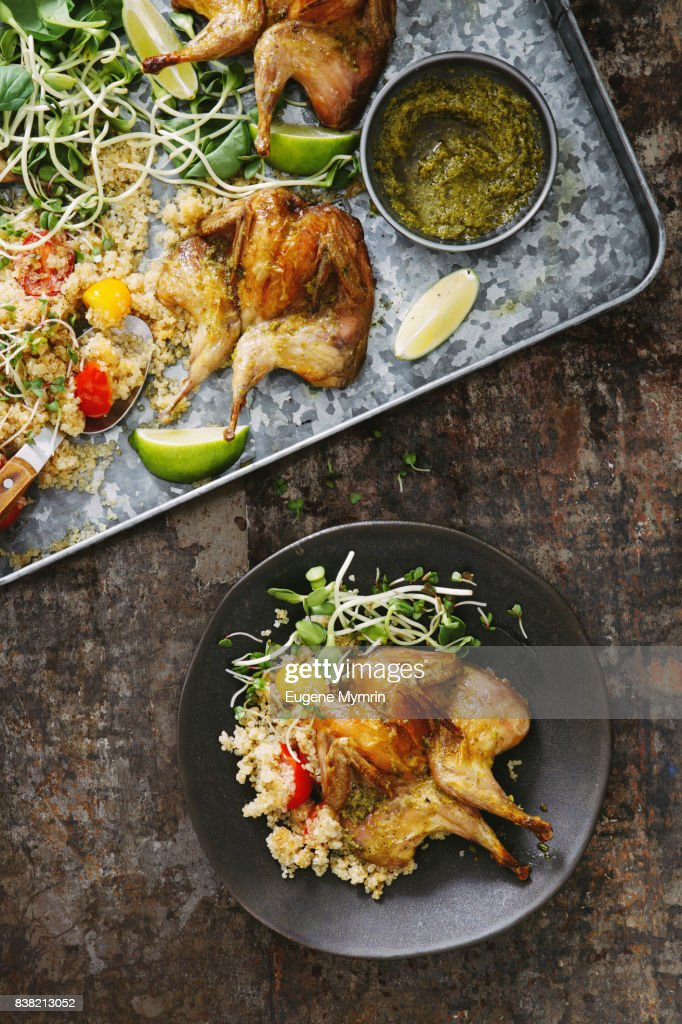Grilled quails with harissa sauce, quinoa and herbs : Stock Photo
