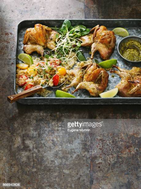 Grilled quails with harissa sauce, quinoa and herbs