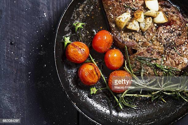 Grilled Ribeye steak entrecote on frying pan