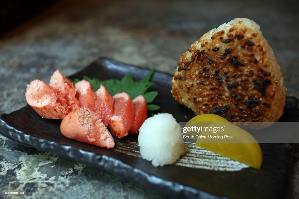 Grilled rice ball and takuan of Keyaki in Lan Kwai Fong, Central. 17APR15 [2015 RESTAURANT REVIEW 48HRS] : News Photo