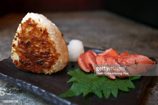 Grilled rice ball and takuan of Keyaki in Lan Kwai Fong Central 17APR15 [2015 RESTAURANT REVIEW 48HRS]