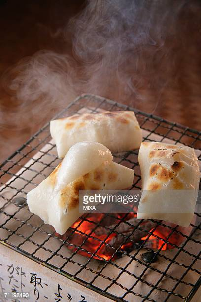 Grilled rice cakes over charcoal fire