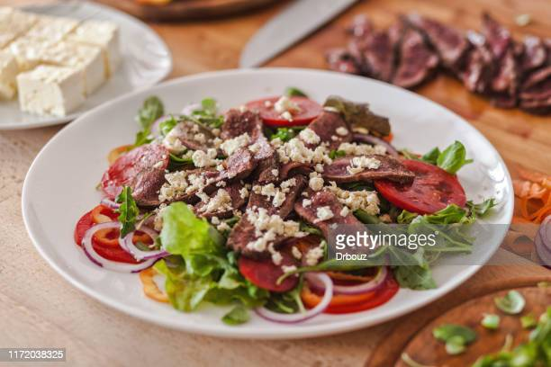 grilled rump steak vegetable salad with soft cheese on plate - arugula stock pictures, royalty-free photos & images
