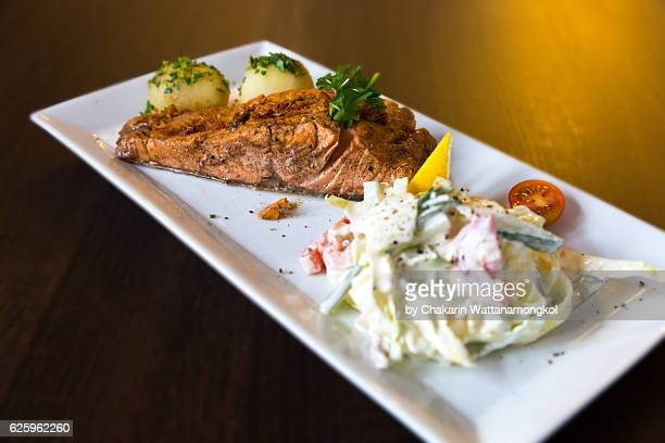 Grilled Salmon Fillet on a white plate.