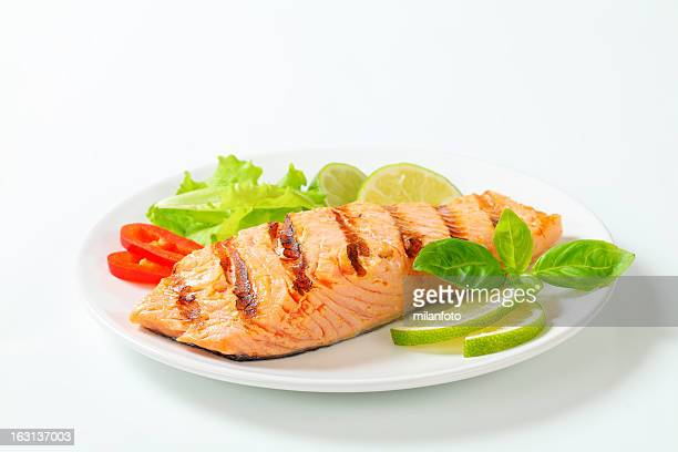 grilled salmon steak on a plate - seafood stock pictures, royalty-free photos & images