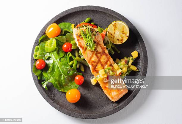grilled salmon steak with green salad - plate stock pictures, royalty-free photos & images