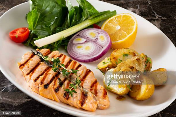 grilled salmon steak with prepared potatoes - fatty acid stock pictures, royalty-free photos & images