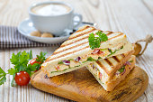 Grilled sandwich with a cappuccino