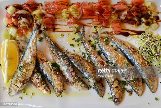 Grilled sardines and tomato