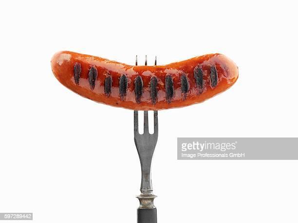 Grilled sausage on fork