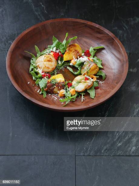 Grilled scallop with red caviar and arugula