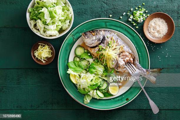 grilled sea bream with vegetables, herbs, ginger, quinoa salad - perch fish stock pictures, royalty-free photos & images