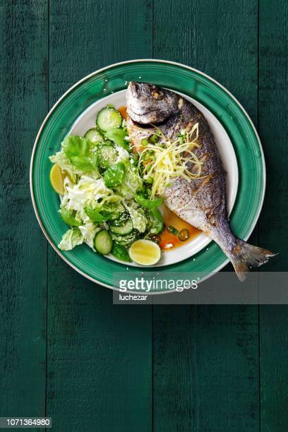 grilled sea bream with vegetables - dorado fish stock photos and pictures