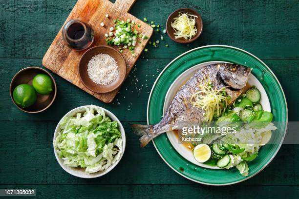 grilled sea bream with vegetables - fish stock pictures, royalty-free photos & images