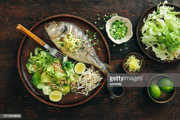 Grilled sea bream with zucchini, herbs, ginger and quinoa salad