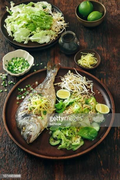 grilled sea bream with zucchini, herbs, ginger and quinoa salad - perch fish stock pictures, royalty-free photos & images