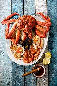 Grilled Seafood assorted platter - King Crab, Prawn Shrimp, Mussels Clams, Scallops in shells, Squid on Grill
