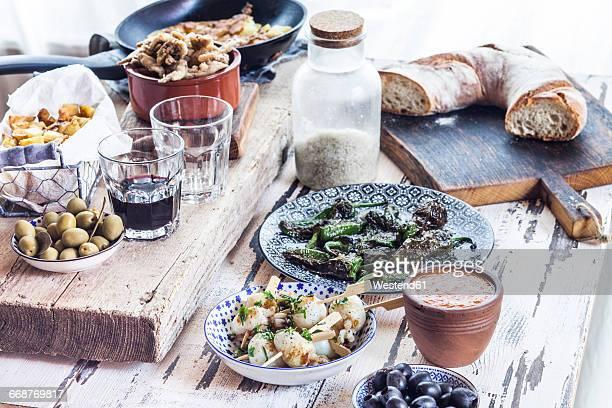 Grilled sepia, olives, pimientos de padron , Mojo sauce, patatas bravas, tortilla de patate, boquerones fritos, vino and bread