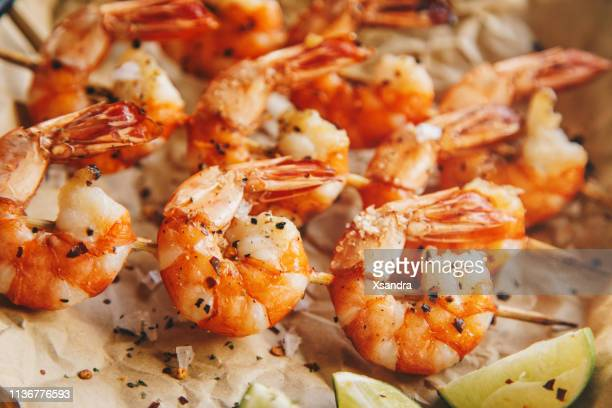 grilled shrimps with seasoning and lime - seafood stock pictures, royalty-free photos & images