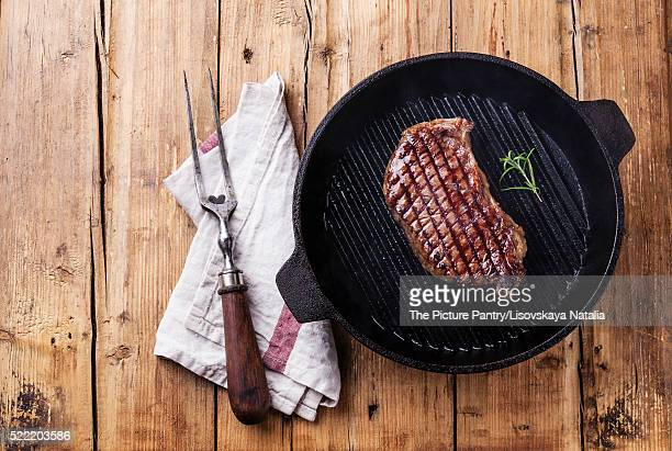 Grilled South American premium beef New York steak on grill pan