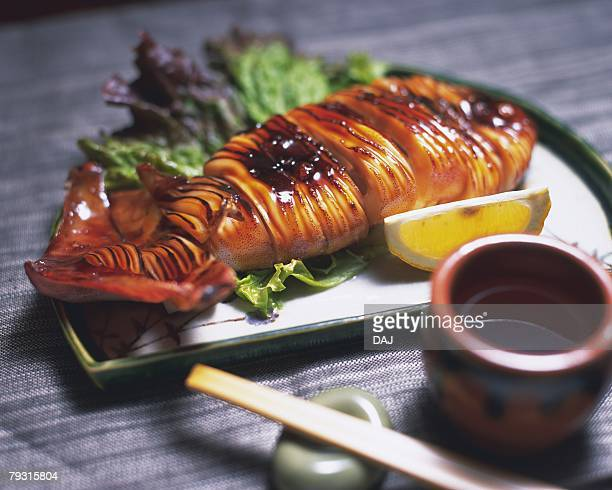Grilled squid on plate, high angle view, differential focus