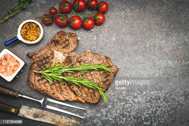 grilled steak - steakhouse stock photos and pictures
