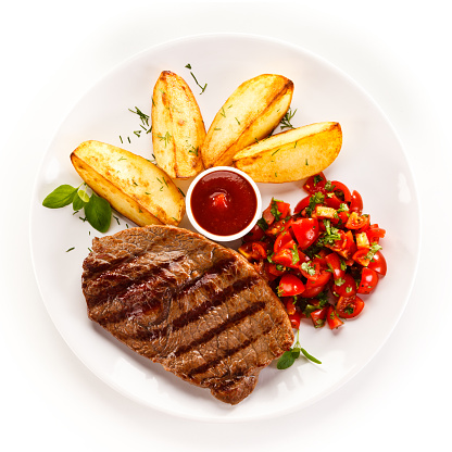 Grilled steak with baked potatoes and vegetables 889913376