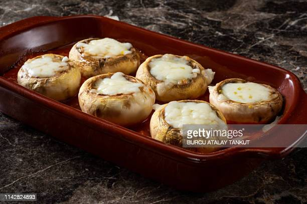 grilled stuffed mushrooms - stuffed stock pictures, royalty-free photos & images