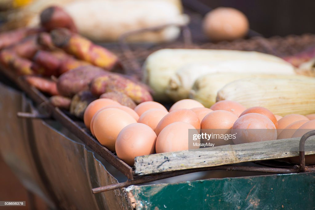 grilled sweet corn, egg and yam on the charcoal stove : Stock Photo