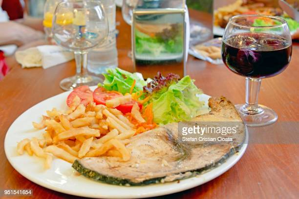 grilled swordfish fillet and french fries - swordfish stock pictures, royalty-free photos & images