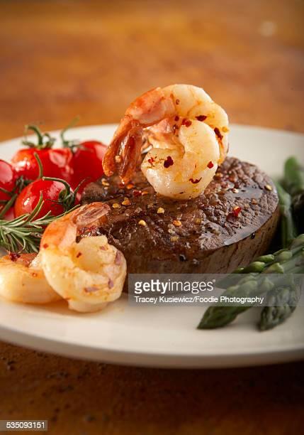 Grilled tenderloin steak with prawns