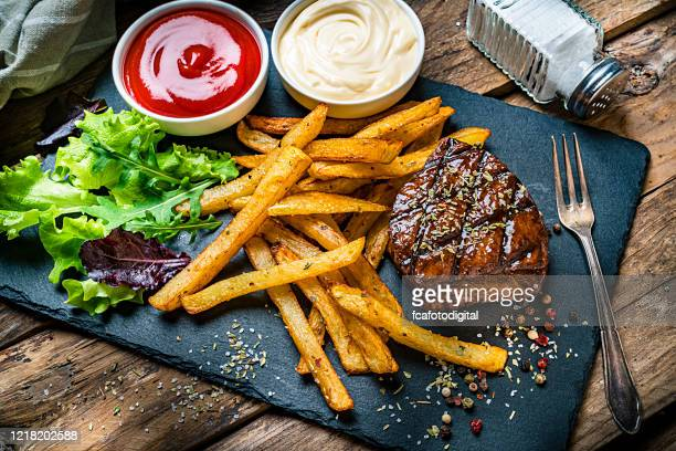 grilled tenderloin with french fries and salad - steak stock pictures, royalty-free photos & images