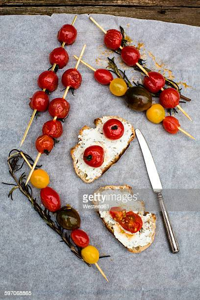 Grilled tomatoes, skewered, rosemary and bread