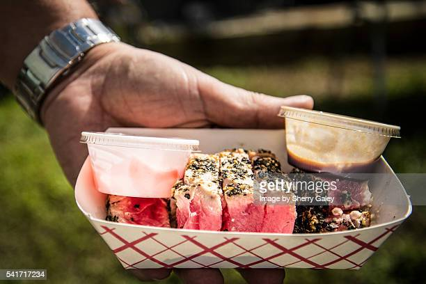 grilled tuna in a snack box at a seafood festival - yellowfin tuna stock photos and pictures