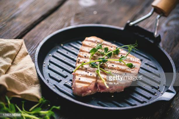 grilled tuna steak - cooking pan stock pictures, royalty-free photos & images