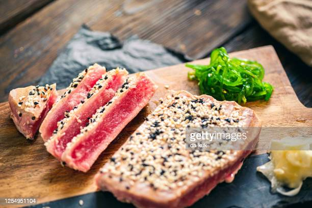 grilled tuna steak with ingredients ready to eat - sesame stock pictures, royalty-free photos & images